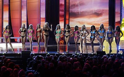 In this September 13, 2015, photo, contestants wear swimsuits as they compete in the 2016 Miss America pageant in Atlantic City, New Jersey. (AP Photo/Mel Evans)