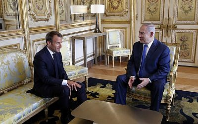 French President Emmanuel Macron, left, and Prime Minister Benjamin Netanyahu attend a meeting at the Elysee Palace, in Paris, June 5, 2018. Philippe Wojazer, pool via AP)