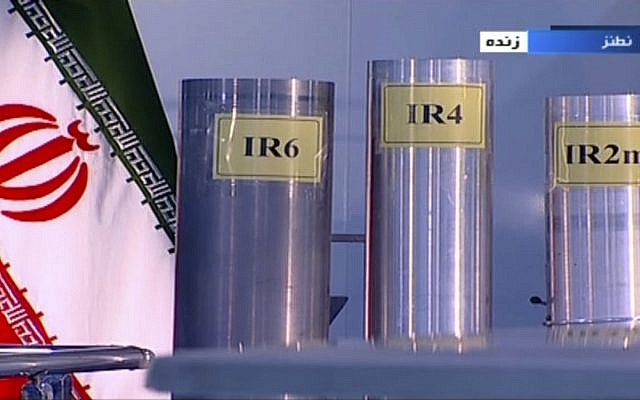 In this frame grab from Islamic Republic Iran Broadcasting, IRIB, state-run TV, three versions of domestically-built centrifuges are shown in a live TV program from Natanz, an Iranian uranium enrichment plant, in Iran, June 6, 2018. (IRIB via AP)