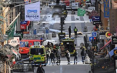Emergency services at the scene of an attack on Drottninggatan street in central Stockholm, April 7, 2017. (Fredrik Sandberg/TT via AP, File)