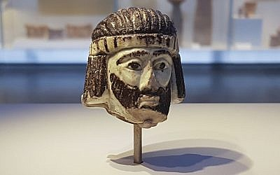 This photo from June 4, 2018, shows a detailed figurine of a king's head on display at the Israel Museum, dating to biblical times, and found last year near Israel's northern border with Lebanon, in Jerusalem. (AP Photo/Ilan Ben Zion)