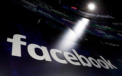 Facebook logo on screens at the Nasdaq MarketSite in New York's Times Square, March 29, 2018. (AP Photo/Richard Drew, File)