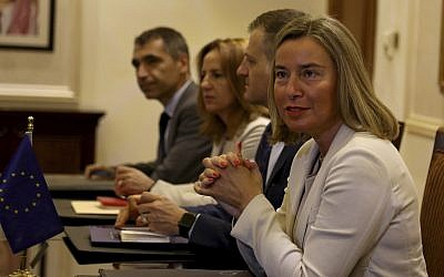 EU High Representative for Foreign Affairs and Security Policy Federica Mogherini, right, attends a meeting with Jordanian Foreign Minister Ayman Safadi in Amman, Jordan, June 10, 2018. (AP Photo/Raad al-Adayleh)