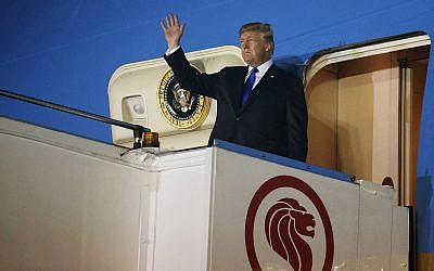 US President Donald Trump arrives at Paya Lebar Air Base for a summit with North Korea's leader Kim Jong Un, June 10, 2018, in Singapore. (AP Photo/Evan Vucci)