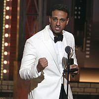 Ari'el Stachel accepts the award for featured actor in a musical for 'The Band's Visit' at the 72nd annual Tony Awards at Radio City Music Hall, on Sunday, June 10, 2018, in New York. (Michael Zorn/Invision/AP)