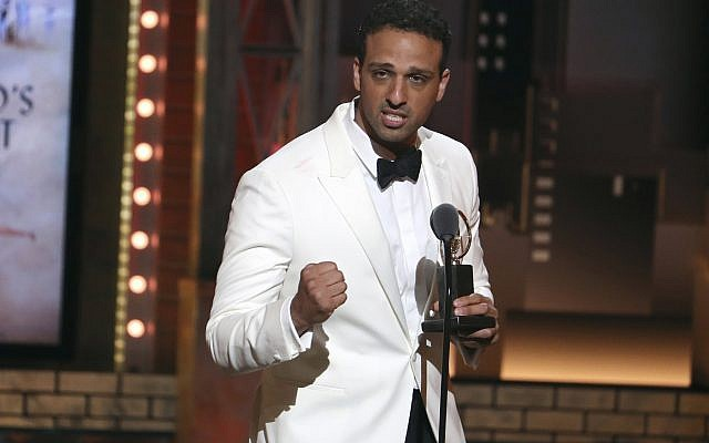 """Ari'el Stachel accepts the award for featured Actor in a musical for """"The Band's Visit"""" at the 72nd annual Tony Awards at Radio City Music Hall on Sunday, June 10, 2018, in New York. (Michael Zorn/Invision/AP)"""
