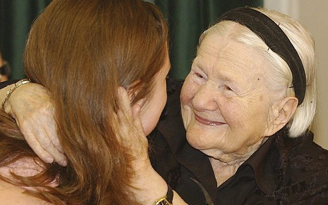 In this Monday, May 30, 2005 photo, Irena Sendler, right, a Polish woman who saved the lives of hundreds of Jewish children during World War II, meets with American students who created a play about her life, in Warsaw, Poland. (AP/Czarek Sokolowski)
