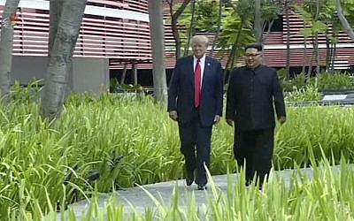In this image made from video released by KRT on June 14, 2018, North Korean leader Kim Jong Un, right, walks with US President Donald Trump during their summit in Singapore, June 12, 2018. (KRT via AP Video)