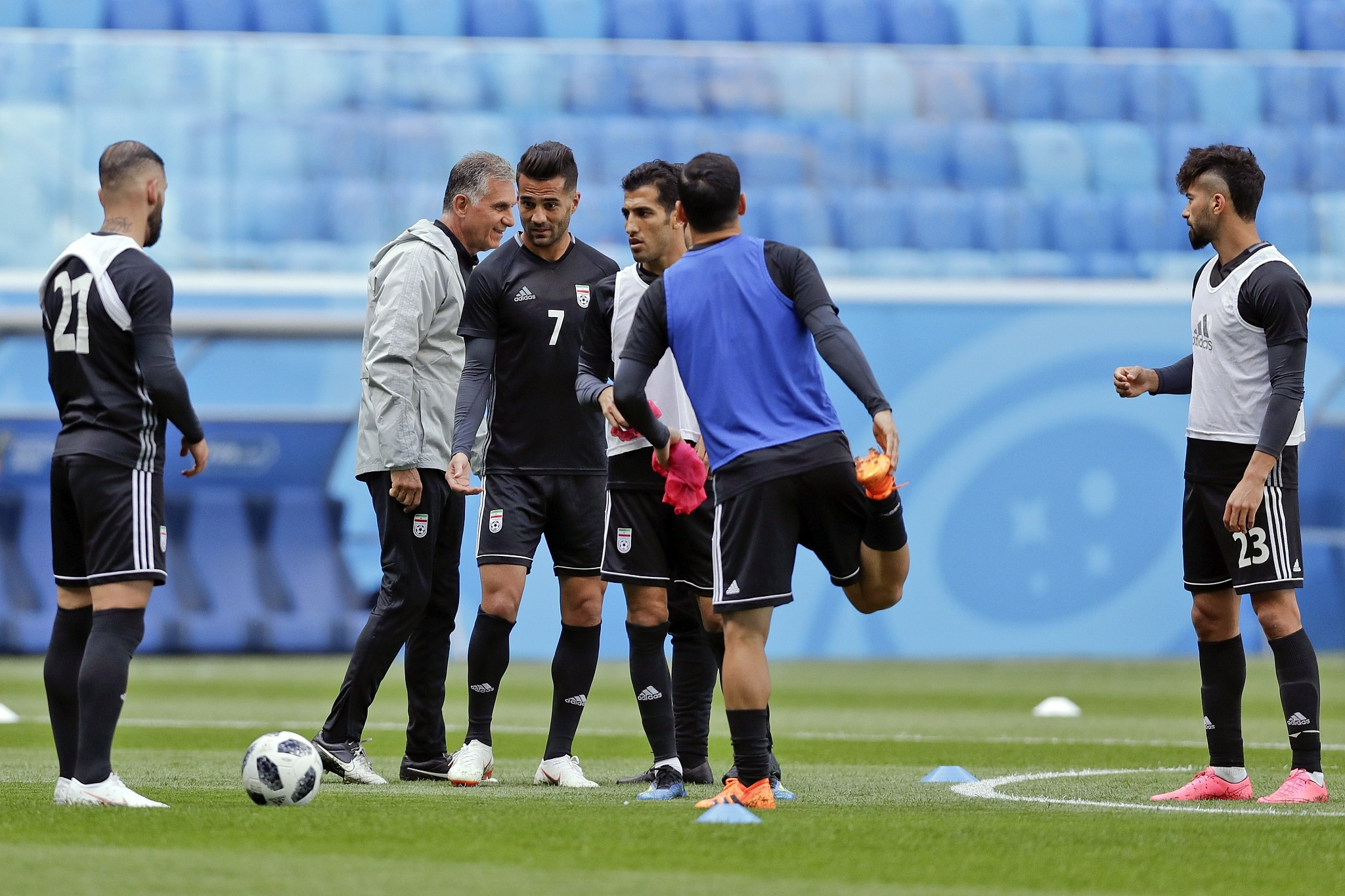 Iran head coach Carlos Queiroz walks among his player during the official training of Iran on the eve of the group B match between Morocco and Iran at the 2018 soccer World Cup in the St. Petersburg Stadium in St. Petersburg Russia Thursday