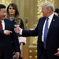 In this Nov. 9, 2017, file photo, US President Donald Trump (right) and China's President Xi Jinping arrive for a state dinner at the Great Hall of the People in Beijing, China. (Thomas Peter/Pool)
