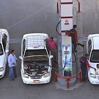 In this June 29, 2017, file photo, taxi drivers chat as they refuel their vehicles at a gas station in Cairo, Egypt. (AP Photo/Amr Nabil, File)