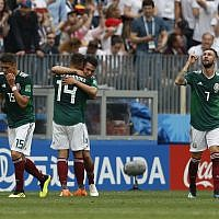 Mexico's Hirving Lozano, center, celebrates scoring his side's opening goal during a match against Germany at the 2018 soccer World Cup in the Luzhniki Stadium in Moscow, Russia, June 17, 2018. (Antonio Calanni/AP)