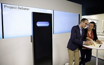 Dan Zafrir, left, and Noa Ovadia, right, prepare for their debate against the IBM Project Debater on June 18, 2018, in San Francisco. (AP Photo/Eric Risberg)