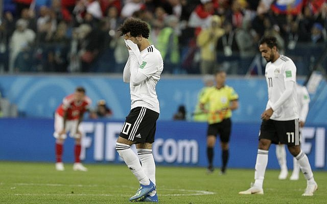 Egypt's Mohamed Salah walks off the pitch after the group A match between Russia and Egypt at the 2018 soccer World Cup in the St. Petersburg stadium in St. Petersburg, Russia, on June 19, 2018. (AP Photo/Gregorio Borgia)
