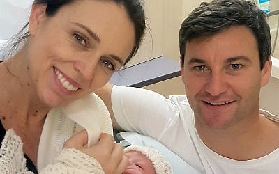 In this photo released by the Office of the Prime Minister of New Zealand, Prime Minster Jacinda Ardern and her partner Clarke Gayford pose with their newborn daughter at the Auckland City Hospital, Thursday, June 21, 2018, in Auckland, New Zealand. (Office of the Prime Minister of New Zealand via AP)