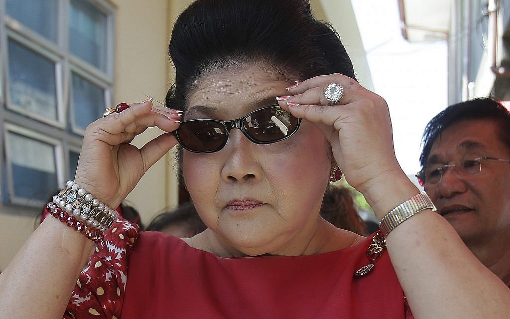 "In this May 5, 2013 file photo, former Philippine first lady Imelda Marcos tours ""Mothering Centers,"" a health and multi-purpose center project of hers, at Ilocos Norte province, northern Philippines. (AP Photo/Aaron Favila, File)"