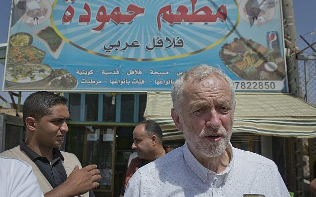 UK Labour Party leader Jeremy Corbyn walks in the main market road during his visit to the Zaatari Syrian Refugee Camp, in Mafraq, Jordan, June 22, 2018. (AP Photo/Nasser Nasser)
