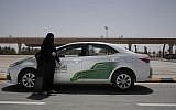In this June 23, 2018 photo, 27-year old driving instructor Mabkhoutah al-Mari stands next to a test drivers car at the Saudi Driving School inside Princess Nora University in Saudi Arabia. (AP/Nariman El-Mofty)