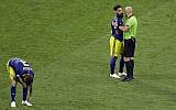 Referee Szymon Marcniak of Poland, right, talks with Sweden's Jimmy Durmaz, middle, at the end the group F match between Germany and Sweden at the 2018 soccer World Cup in the Fisht Stadium in Sochi, Russia, Saturday, June 23, 2018. (AP/Sergei Grits)