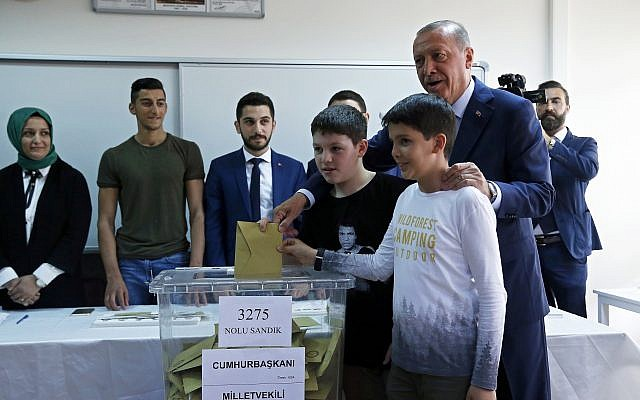 Turkey's President and ruling Justice and Development Party, or AKP, leader Recep Tayyip Erdogan casts his ballot in Turkey's elections at a polling station in Istanbul, June 24, 2018. (AP Photo/Lefteris Pitarakis)