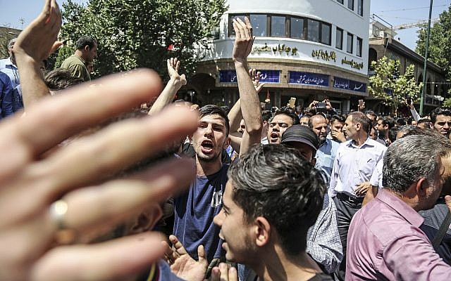 A group of protesters chant slogans at the main gate of old grand bazaar in Tehran, Iran, on June 25, 2018. (Iranian Labor News Agency via AP)