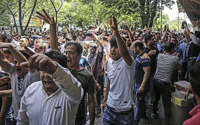 A group of protesters chant slogans at the old grand bazaar in Tehran, Iran, on June 25, 2018. (Iranian Labor News Agency via AP)