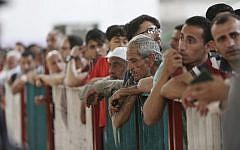 This May 22, 2018, file photo shows Palestinians waiting to cross the Gaza-Egypt border to the Egyptian side at the Rafah crossing. (AP Photo/Adel Hana, File)