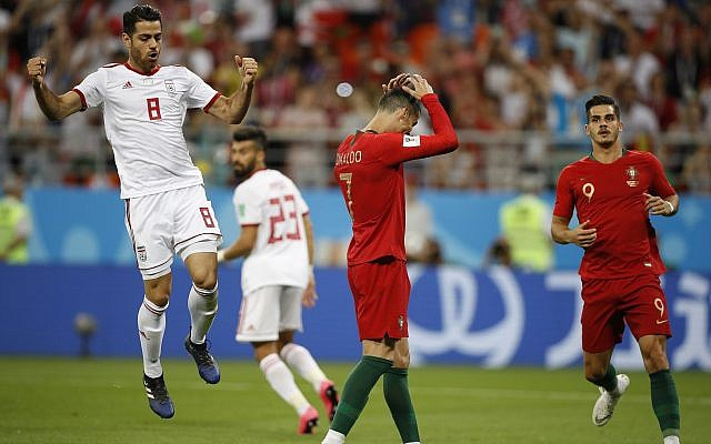 Portugal's Cristiano Ronaldo, center, reacts after failing to score a penalty as Iran's Morteza Pouraliganji reacts, left, during the group B match between Iran and Portugal at the 2018 soccer World Cup at the Mordovia Arena in Saransk, Russia, June 25, 2018. (Francisco Seco/AP)