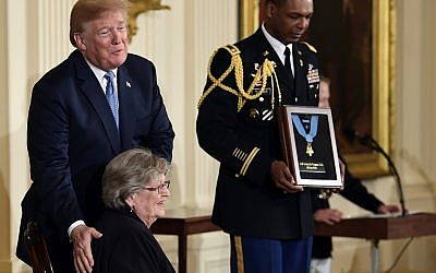 US President Donald Trump, before he awards the Medal of Honor to 1st Lt. Garlin Conner,a posthumous recognition accepted by his widow Pauline Conner, during a ceremony in the East Room of the White House in Washington, DC, June 26, 2018. (AP Photo/ Susan Walsh)