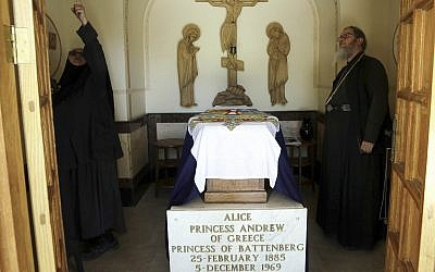 A Russian priest stands by the grave of Princess Alice of Battenberg and Greece, great-grandmother of Prince William, at the Mary Magdalene Church, in Jerusalem, on June 27, 2018. (AP Photo/Mahmoud Illean)
