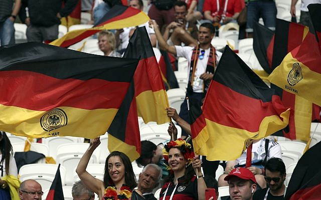 Fan wave German flags as they wait for the start of the group F match between South Korea and Germany, at the 2018 soccer World Cup in the Kazan Arena in Kazan, Russia, Wednesday, June 27, 2018. (AP/Thanassis Stavrakis)