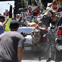 In this August 12, 2017, file photo, people fly into the air as a vehicle is driven into a group of protesters demonstrating against a white nationalist rally in Charlottesville, Virginia. (Ryan M. Kelly/The Daily Progress via AP, File)