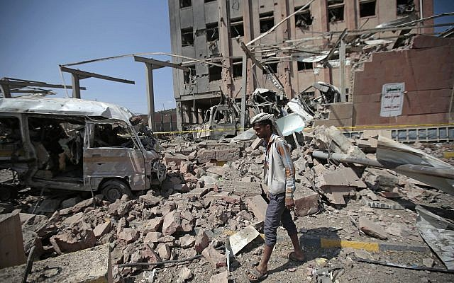 A man inspects rubble after a Saudi-led coalition airstrike in Sanaa, Yemen, February 4, 2018. (Hani Mohammed/AP)