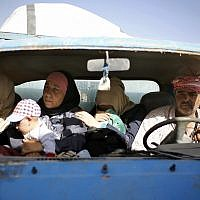 Syrian refugees gather in their vehicles getting ready to cross into Syria from the eastern Lebanese border town of Arsal, Lebanon, Thursday, June 28, 2018. Dozens of Syrian refugees in Lebanon have started to cross the border, going back home to war-torn Syria. (AP Photo/Bilal Hussein)
