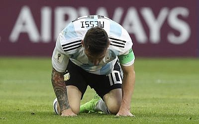 Argentina's Lionel Messi kneels on the pitch during the round of 16 match between France and Argentina, at the 2018 soccer World Cup at the Kazan Arena in Kazan, Russia, on June 30, 2018. (AP Photo/Thanassis Stavrakis)