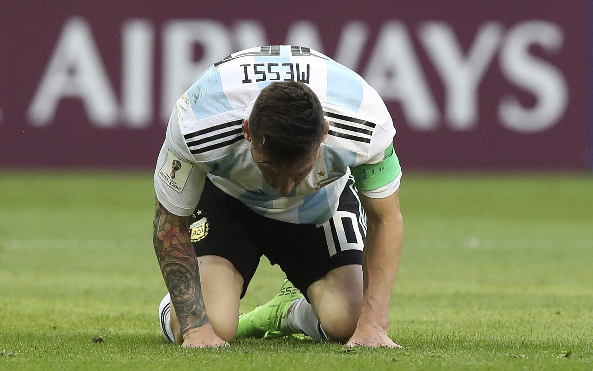 ffefa81cb Argentina's Lionel Messi kneels on the pitch during the round of 16 match  between France and
