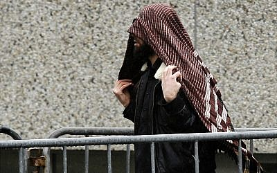 An unidentified supporter of the 'Hofstad' terror group arrives at a trial for the group's members in Amsterdam, The Netherlands, Friday, March 10, 2006. The group includes Mohammed Bouyeri, the convicted murderer of filmmaker Theo van Gogh. (AP Photo/ Fred Ernst)