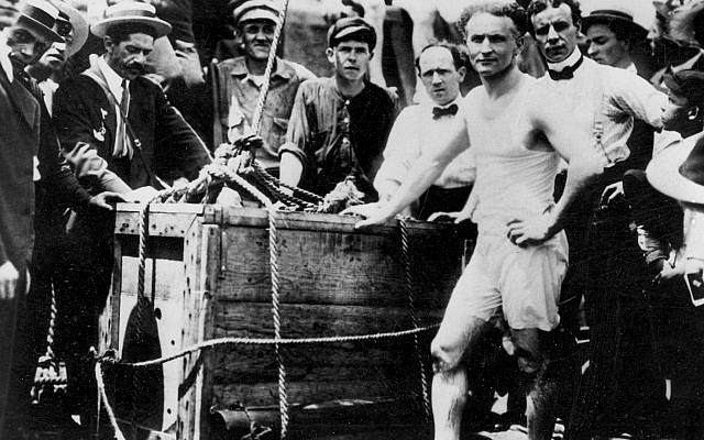 Escape artist Harry Houdini is shown before being lowered in a packing crate into the ice-covered Detroit River in 1907. (AP Photo)