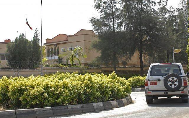 A car drives past the Iranian Embassy in Abuja Nigeria Friday Nov. 12 2010