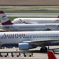 In this this July 2, 2009 file photo, planes of Austrian Airlines stand at Vienna-Schwechat airport in Vienna, Austria. (AP Photo/Ronald Zak, File)