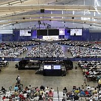 Illustrative image of people attending the 220th General Assembly (2012) of the Presbyterian Church (USA) at the David Lawrence Convention Center in Pittsburgh listen to a session on Thursday, July 5, 2012. (AP Photo/Keith Srakocic)
