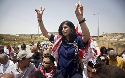 Palestinian lawmaker Khalida Jarrar is greeted by supporters near the West Bank town of Tulkarem, June 3, 2016. (Majdi Mohammed/ AP)
