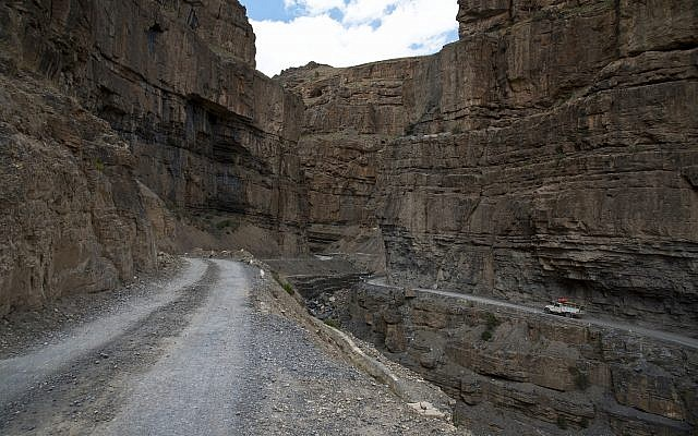 In this August 15, 2016, photo, a car drives along a mountain road that leads to Spiti Valley, a remote Himalayan valley situated at 4000 meter above sea level, India. (AP Photo/Thomas Cytrynowicz)