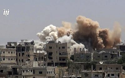 This frame grab from video provided on  June 12, 2017, by Nabaa Media, a Syrian opposition media outlet that is consistent with independent AP reporting, shows smoke rising over buildings that were hit by Syrian government forces bombardment, in Daraa city, southern Syria. (Nabaa Media, via AP)