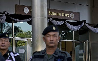 Illustrative: A Thai police officers stand guard outside a courthouse  Wednesday, Aug. 2, 2017, in Bangkok, Thailand (AP Photo/Gemunu Amarasinghe)