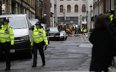 Police near Charing Cross railway station in central London, Tuesday, January 23, 2018 (AP Photo/Alastair Grant)