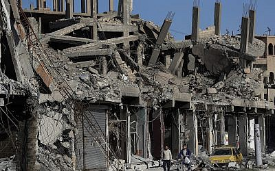 In this Thursday, April 5, 2018 photo, rubble of buildings line a street that was damaged during fighting between US-backed Syrian Democratic Forces fighters and Islamic State militants, in Raqqa, Syria.(AP/Hussein Malla)