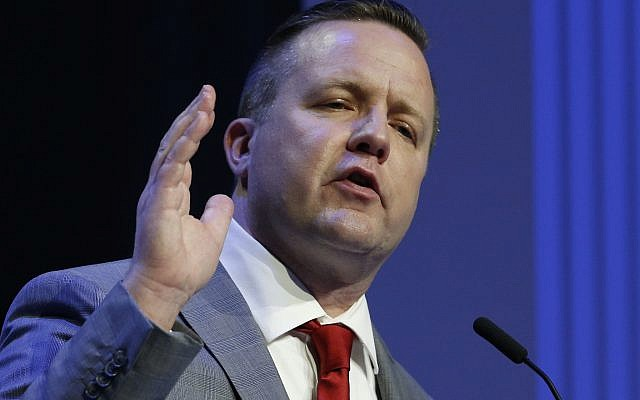 Republican primary senatorial candidate Corey Stewart gestures during a debate with E. W. Jackson and Del. Nick Freitas at Liberty University in Lynchburg, Virginia, April 19, 2018. (AP Photo/Steve Helber)