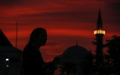 People walk in the historic Sultanahmet district of Istanbul, May 16, 2018 on the first day of the fasting month of Ramadan. (AP Photo/Emrah Gurel)