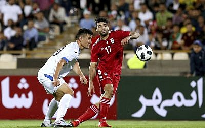 Iran's Mehdi Taremi (R) plays the ball during the international friendly soccer match between Iran and Uzbekistan at the Azadi Stadium in Tehran, Iran on May 19, 2018. (AP Photo/Ebrahim Noroozi)